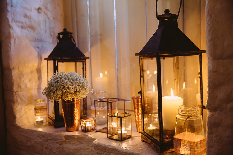 Lanterns Candles Flowers Decor Tea Lights Magical Winter Rustic Wonderland Wedding http://hayleybaxterphotography.com/