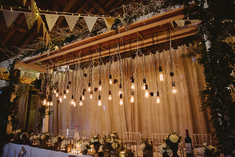 Top Table Festoon Edison Lights Hanging Bunting Flowers Candles Decor Magical Winter Rustic Wonderland Wedding http://hayleybaxterphotography.com/