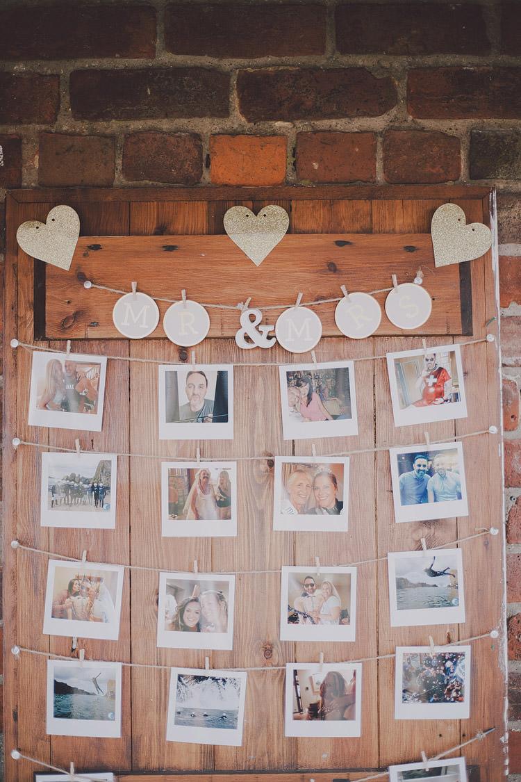 Wooden Polariod Photo Wall Door Chic Rustic Grey Barn Wedding http://www.kevelkinsphotography.co.uk/