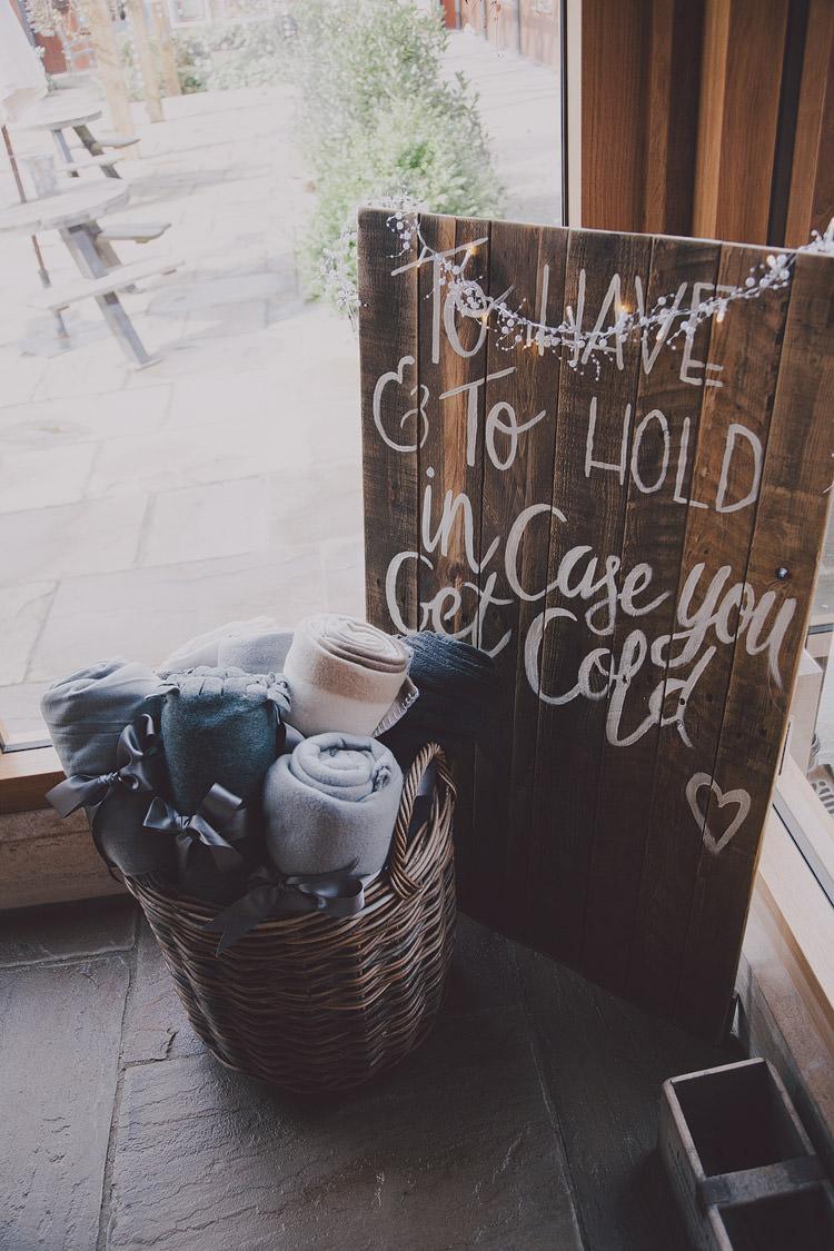 Blankets Warm Cosy Idea Sign Chic Rustic Grey Barn Wedding http://www.kevelkinsphotography.co.uk/