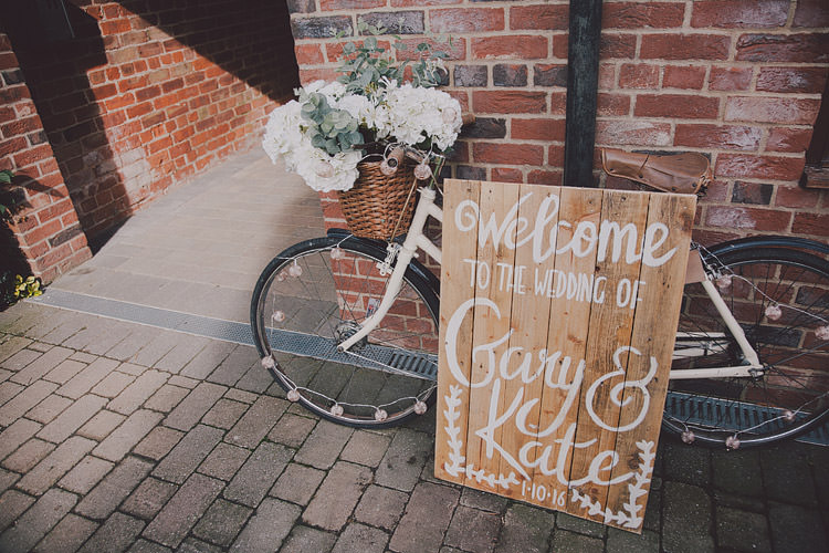 Bicycle Decor Flowers Sign Basket Wooden Chic Rustic Grey Barn Wedding http://www.kevelkinsphotography.co.uk/