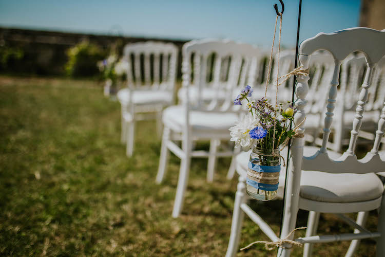 Jar Flowers Chair Ceremony Aisle Pew End Summertime French Village Destination Wedding http://www.pippacarvellphotography.com/