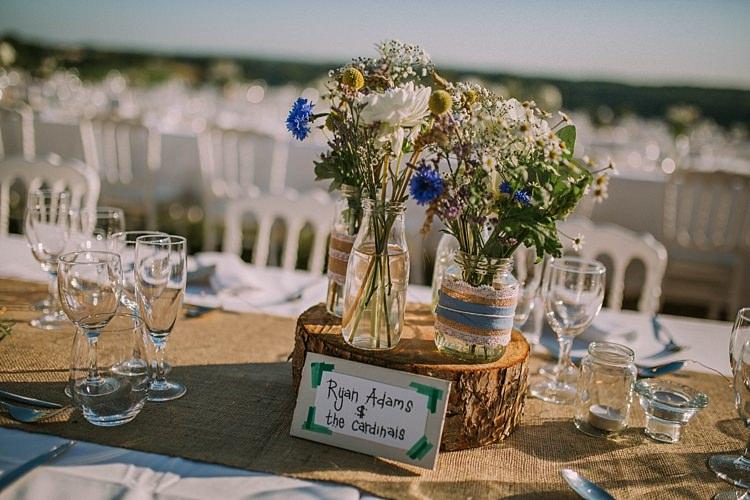 Hessian Burlap Jar Lace Flowers Log Stand Table Decor Summertime French Village Destination Wedding http://www.pippacarvellphotography.com/
