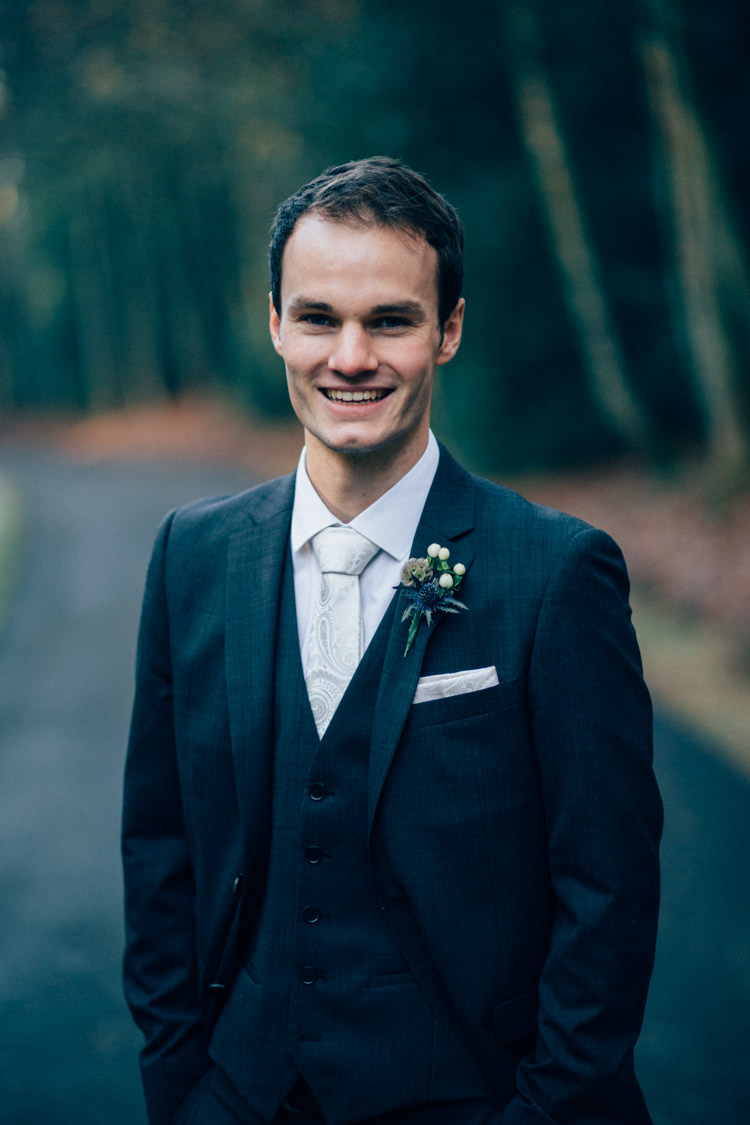 Groom DKNY Moss Bros Heartwarming Festive Winter Wedding http://www.nikkivandermolen.com/