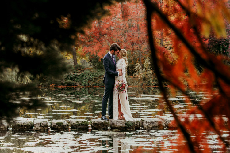 Bride Lace Backless Bridal Gown Intricate Autumn Leaves Headpiece Bouquet Garden Roses Seasonal Leaves Berries Groom Charcoal Suit Purple Patterned Tie Trees Lake From Dawn To Eternity Autumnal Wedding Ideas http://www.nataliaibarra.com