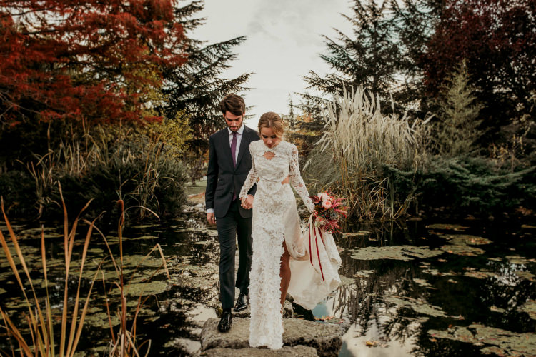 Bride Lace Backless Bridal Gown Bouquet Garden Roses Seasonal Leaves Berries Maroon Cream Ribbons Groom Charcoal Suit Purple Patterned Tie Trees From Dawn To Eternity Autumnal Wedding Ideas http://www.nataliaibarra.com