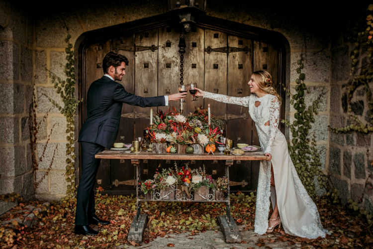 Bride Lace Backless Bridal Gown Intricate Autumn Leaves Headpiece Groom Charcoal Suit Rustic Recption Table Setting Fresh Flowers Pumpkins Gold Candlesticks From Dawn To Eternity Autumnal Wedding Ideas http://www.nataliaibarra.com