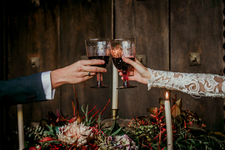 Rustic Reception Bride Lace Bridal Gown Groom Charcoal Suit Fresh Flowers Gold Candlesticks Wine Goblets From Dawn To Eternity Autumnal Wedding Ideas http://www.nataliaibarra.com