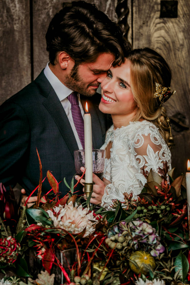Bride Lace Backless Bridal Gown Intricate Autumn Leaves Headpiece Groom Charcoal Suit Purple Patterned Tie Rustic Reception Table Setting Fresh Flowers Gold Candlesticks From Dawn To Eternity Autumnal Wedding Ideas http://www.nataliaibarra.com