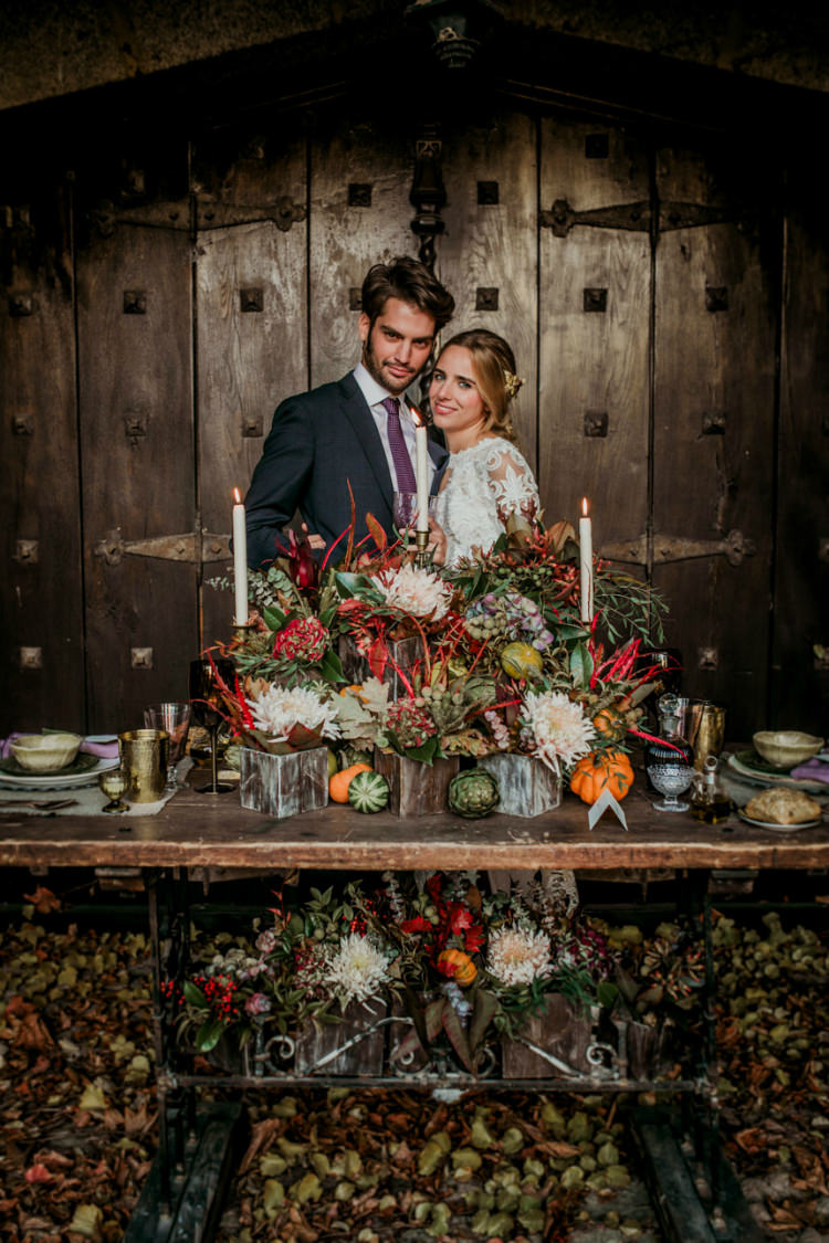 Bride Lace Backless Bridal Gown Intricate Autumn Leaves Headpiece Groom Charcoal Suit Purple Patterned Tie Rustic Reception Table Setting Fresh Flowers Pumpkins Gold Candlesticks From Dawn To Eternity Autumnal Wedding Ideas http://www.nataliaibarra.com