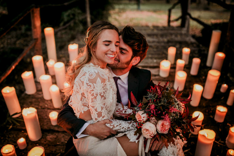 Bride Lace Backless Bridal Gown Bouquet Cream Garden Roses Seasonal Leaves Berries Maroon Cream Ribbons Groom Charcoal Suit Purple Patterned Tie Candles From Dawn To Eternity Autumnal Wedding Ideas http://www.nataliaibarra.com