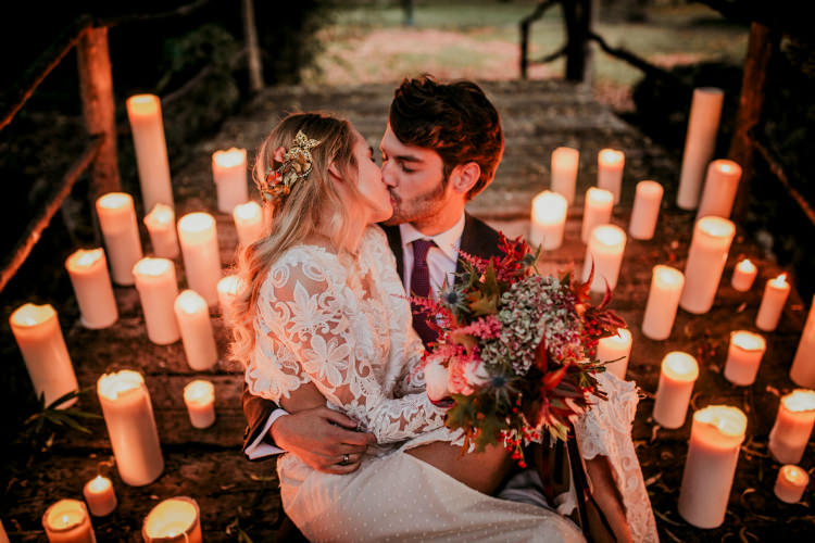 Bride Lace Backless Bridal Gown Autumn Leaves Headpiece Bouquet Cream Garden Roses Seasonal Leaves Berries Maroon Cream Ribbons Groom Charcoal Suit Purple Patterned Tie Candles From Dawn To Eternity Autumnal Wedding Ideas http://www.nataliaibarra.com