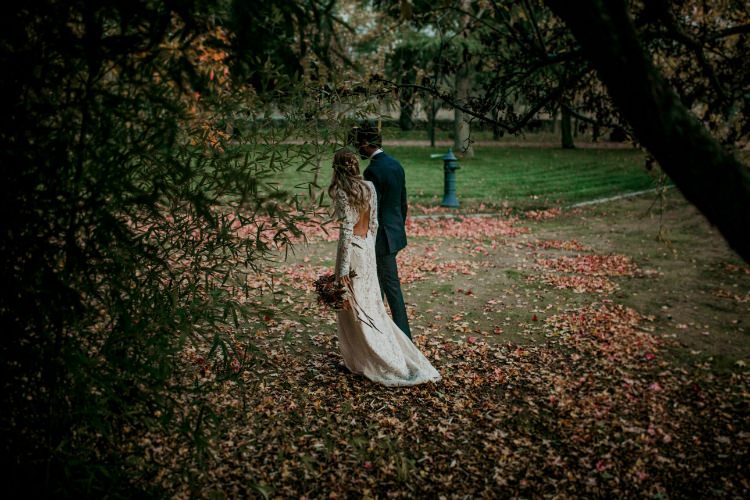 Bride Lace Backless Bridal Gown Autumn Leaves Headpiece Bouquet Groom Charcoal Suit From Dawn To Eternity Autumnal Wedding Ideas http://www.nataliaibarra.com