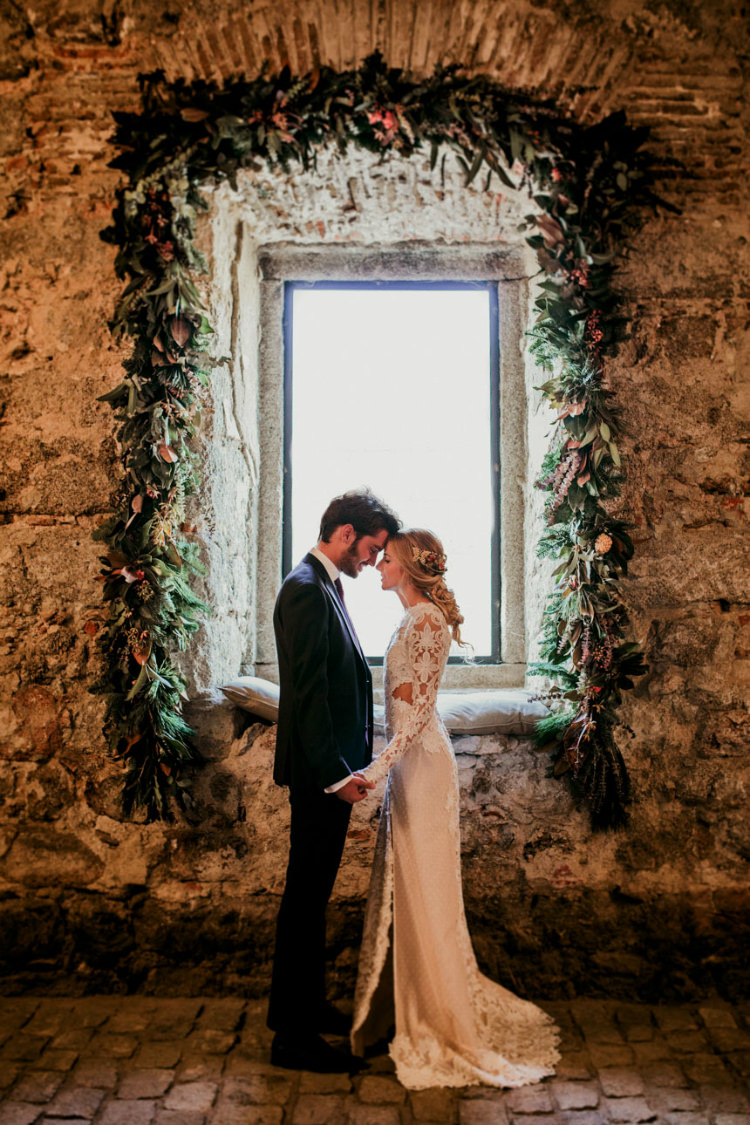 Bride Lace Backless Bridal Gown Intricate Autumn Leaves Headpiece Groom Charcoal Suit Purple Patterned Tie Window Florals Greenery From Dawn To Eternity Autumnal Wedding Ideas http://www.nataliaibarra.com
