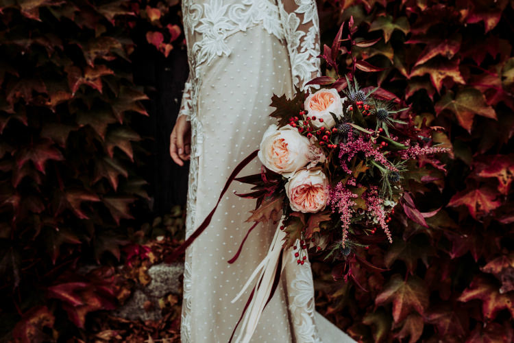 Bride Lace Backless Bridal Gown Bouquet Cream Garden Roses Seasonal Leaves Berries Long Maroon Cream Ribbons Groom Charcoal Suit Autumn Leaves From Dawn To Eternity Autumnal Wedding Ideas http://www.nataliaibarra.com