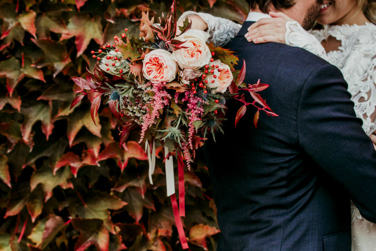 Bride Lace Backless Bridal Gown Bouquet Cream Garden Roses Seasonal Leaves Berries Long Ribbons From Dawn To Eternity Autumnal Wedding Ideas http://www.nataliaibarra.com