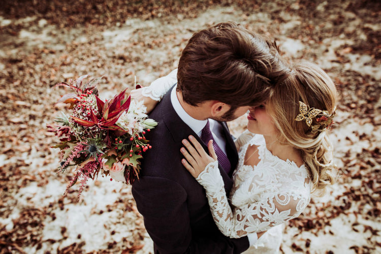 Bride Lace Backless Bridal Gown Intricate Autumn Leaves Headpiece Bouquet Groom Charcoal Suit Purple Patterned Tie From Dawn To Eternity Autumnal Wedding Ideas http://www.nataliaibarra.com