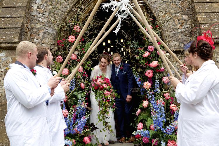 Archway Exit Church Bride Groom Farmer Floral Artistic Farm Wedding http://elizabetharmitage.com/