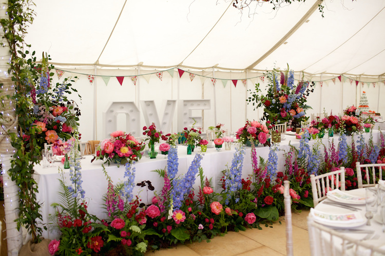 Marquee Flowers Top Table Summer Garden Wild Large Pink Blue Floral Artistic Farm Wedding http://elizabetharmitage.com/