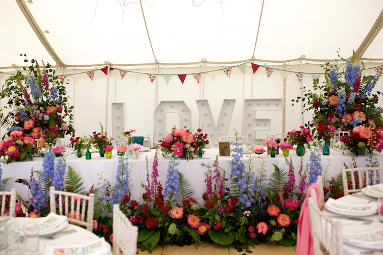 Top Table LOVE Letter Lights Summer Marquee Flowers Pink Blue Floral Artistic Farm Wedding http://elizabetharmitage.com/