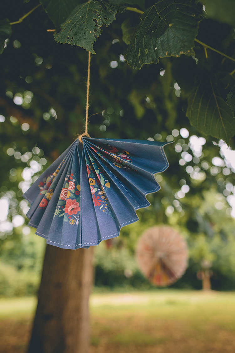 Hanging Paper Fan Decor Homespun Fun Country Barn Wedding http://storyandcolour.co.uk/