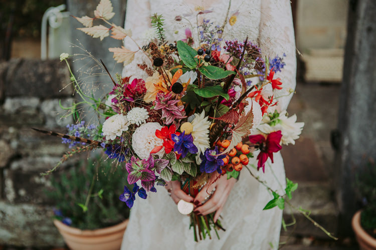 Bouquet Fowers Bride Bridal Feather Dahlias Wild Naturual Orange Red Yellow Autumn Weekend Extravaganza Tipi Wedding http://bloomweddings.co.uk/