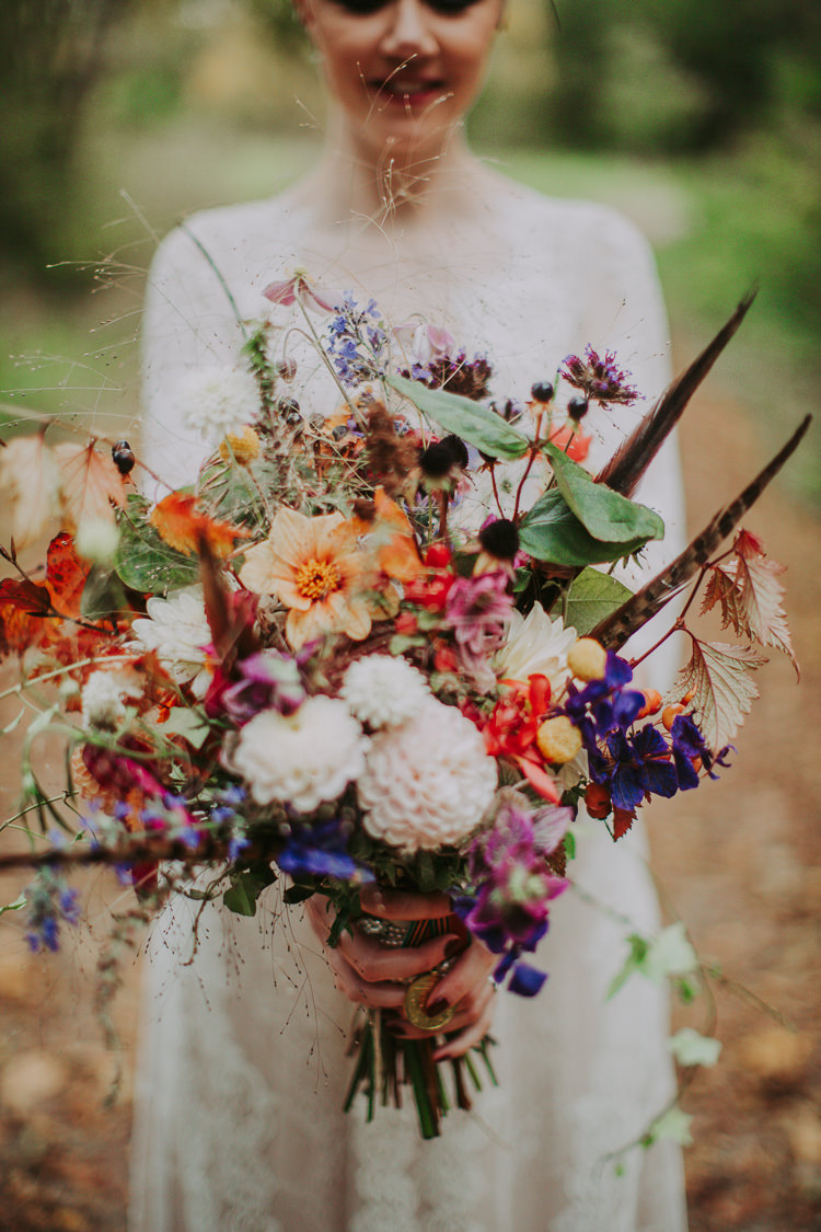 Bouquet Fowers Bride Bridal Feather Dahlias Wild Naturual Orange Red Autumn Weekend Extravaganza Tipi Wedding http://bloomweddings.co.uk/