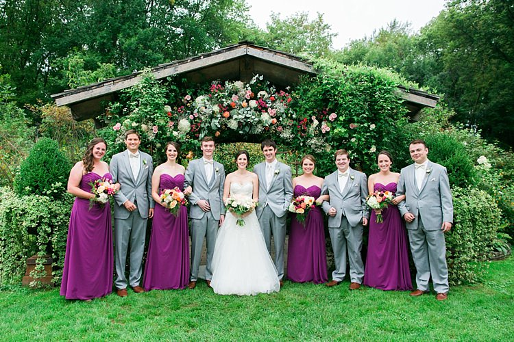 Bridal Party Bride Embellished Strapless Bridal Gown Bouquet Pale Pink White Roses Groom Light Grey Suit White Vest Tie Rose Buttonhole Bridesmaids Purple Strapless Dresses Bright Multicoloured Bouquets Groomsmen Light Grey Suits Bowties Floral Arbour Flower Farm Outdoor Wedding Minnesota http://eileenkphoto.com/