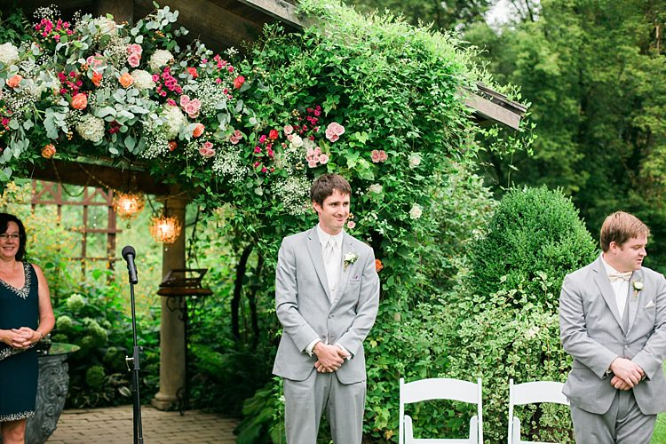 Outdoor Ceremony Groom Light Grey Suit White Vest Tie Rose Buttonhole Groomsmen Light Grey Suit Celebrant Floral Arbour Flower Farm Outdoor Wedding Minnesota http://eileenkphoto.com/