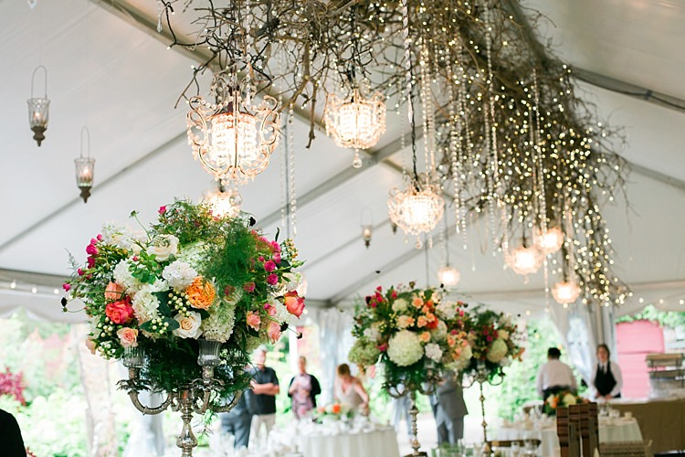 Reception Large Multicoloured Floral Centrepieces Silver Candlesticks Hanging Décor Branches Chandeliers Fairy Lights Flower Farm Outdoor Wedding Minnesota http://eileenkphoto.com/