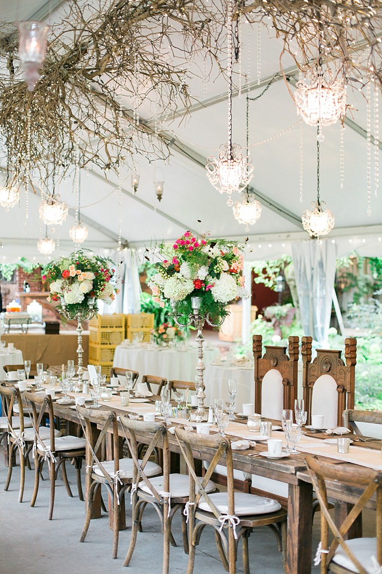 Reception Hanging Decor Chandeliers Wooden Table Large Bright Bouquets Centrepieces Fairy Lights Flower Farm Outdoor Wedding Minnesota http://eileenkphoto.com/