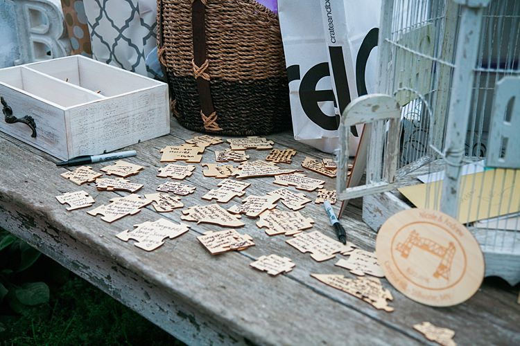 Reception Guest Book Puzzle Pieces Vintage Bird Cage Flower Farm Outdoor Wedding Minnesota http://eileenkphoto.com/