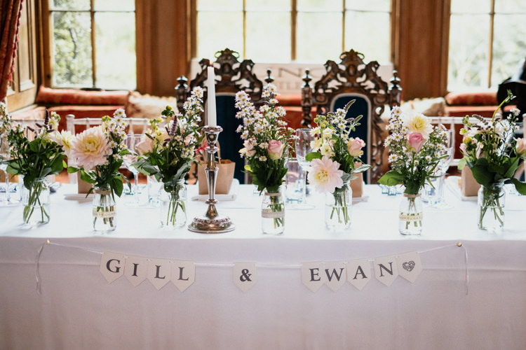 Top Table Floral Bunting Candle Vases Relaxed Stylish Outdoor Wedding http://www.euanrobertsonweddings.com/