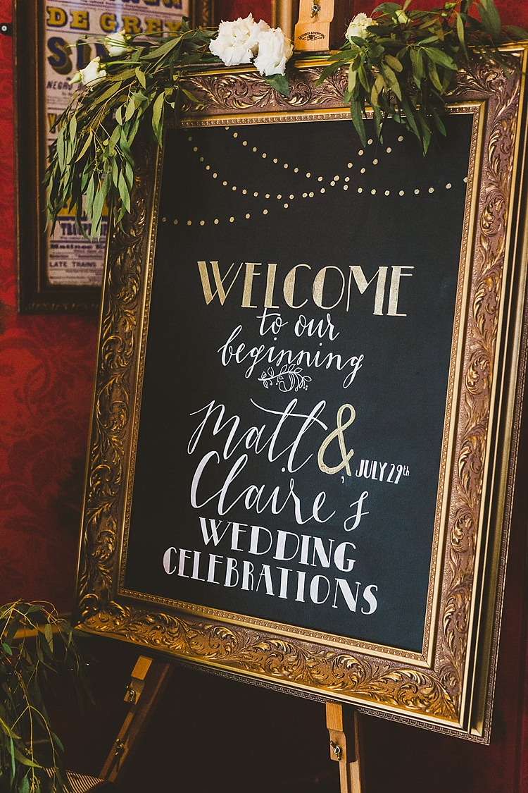 Welcome Sign Chalk Black Board Gold Flowers Foliage Glamorous Gatsby City Hall Wedding http://www.emmakenny.com/