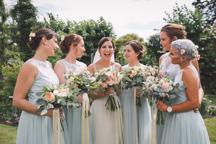 Long Mint Green Blue Bridesmaid Dresses Bouquets Ribbons Flowers Light Pretty Summer Barn Wedding http://www.koweddings.com/
