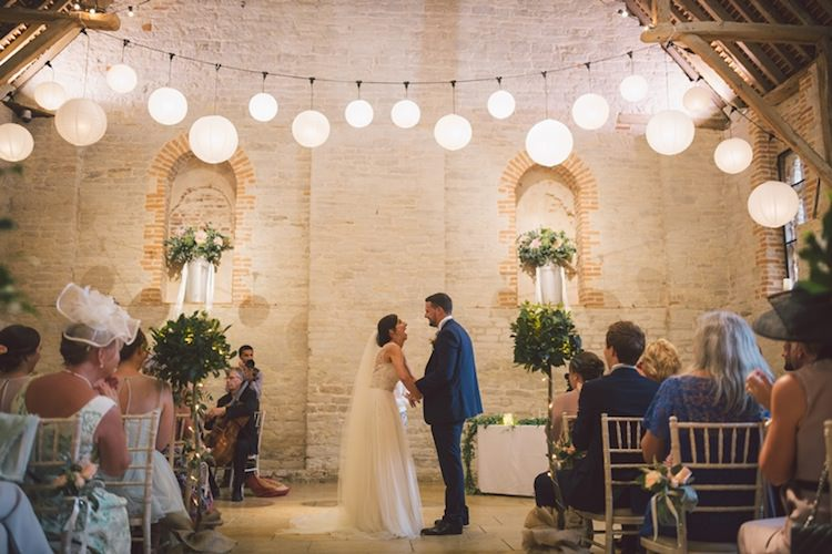 Lanterns Ceremony Hanging Backdrop Light Pretty Summer Barn Wedding http://www.koweddings.com/