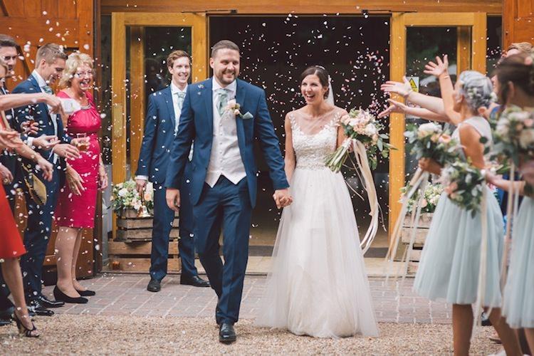 Confetti Throw Light Pretty Summer Barn Wedding http://www.koweddings.com/