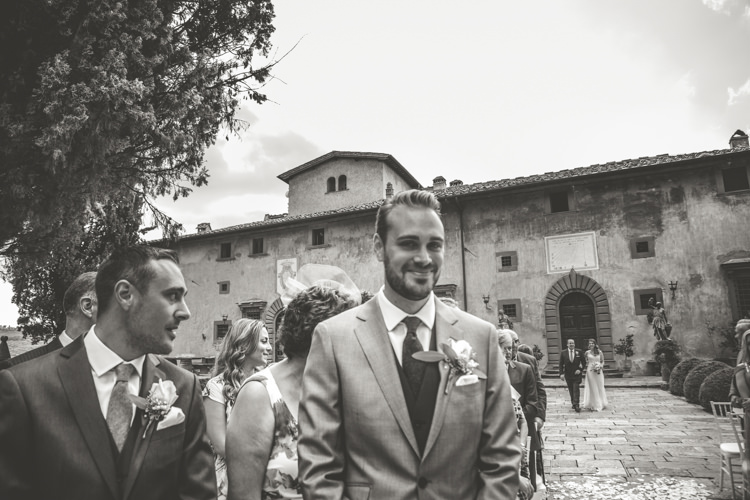 Outdoor Ceremony Groom Light Blue Suit Rose Buttonhole Groomsmen Guests Bride Father Entrance Historic Pink Villa Romantic Intimate Tuscany Destination Wedding http://angelicabraccini.com/