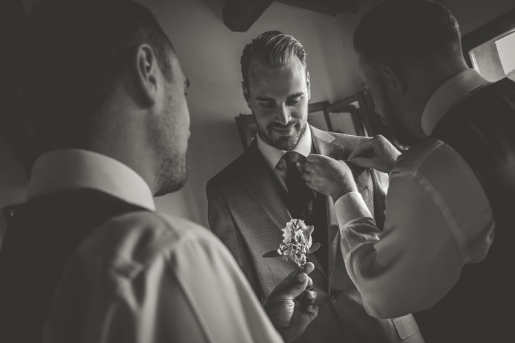 Groom Groomsmen Ceremony Preparations Rose Buttonhole Romantic Intimate Tuscany Destination Wedding http://angelicabraccini.com/