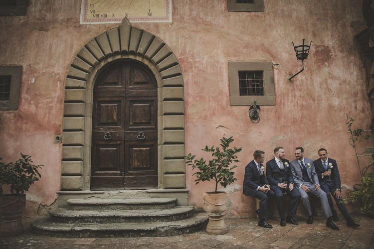 Groom Light Blue Suit White Shirt Textured Blue Tie Rose Buttonhole Groomsmen Dark Blue Suits White Shirt Blue Ties Historic Pink Villa Romantic Intimate Tuscany Destination Wedding http://angelicabraccini.com/