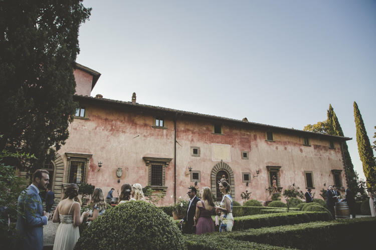 Outdoor Ceremony Location Historic Pink Villa Guests Hedges Romantic Intimate Tuscany Destination Wedding http://angelicabraccini.com/