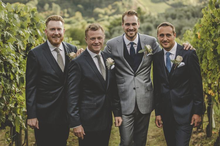 Groom Light Blue Suit Blue Vest Textured Blue Tie Groomsmen Dark Blue Suit White Shirt Different Ties Rose Buttonholes Vineyard Romantic Intimate Tuscany Destination Wedding http://angelicabraccini.com/