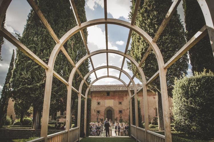 Ceremony Location Historic Pink Villa Archway Trees Hedges Romantic Intimate Tuscany Destination Wedding http://angelicabraccini.com/