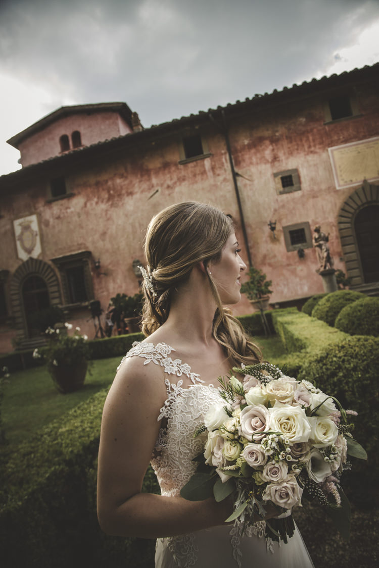 Outdoor Ceremony Bride Lace Tulle Stella York Bridal Gown Bouquet White Pink Roses Loose Curls Hairstyle Crystal Hairpiece Historic Pink Villa Romantic Intimate Tuscany Destination Wedding http://angelicabraccini.com/