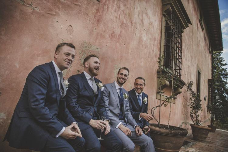 Groom Light Blue Suit White Shirt Textured Blue Tie Rose Buttonhole Groomsmen Dark Blue Suit Blue Ties Historic Pink Villa Romantic Intimate Tuscany Destination Wedding http://angelicabraccini.com/