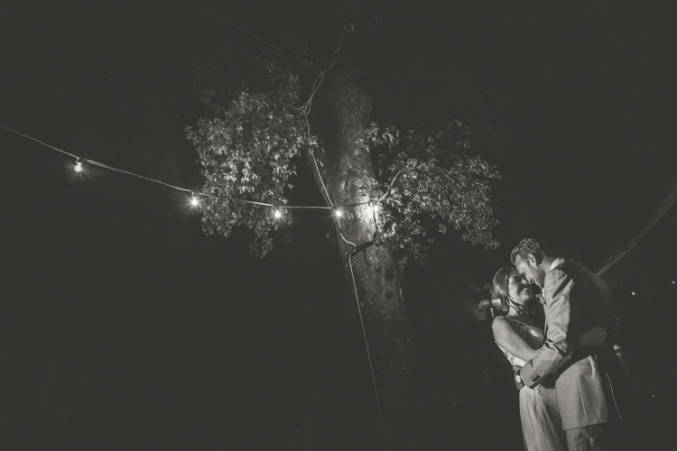 Reception Outdoor First Dance Bride Lace Tulle Stella York Bridal Gown Groom Light Blue Suit Trees Fairy Lights Romantic Intimate Tuscany Destination Wedding http://angelicabraccini.com/