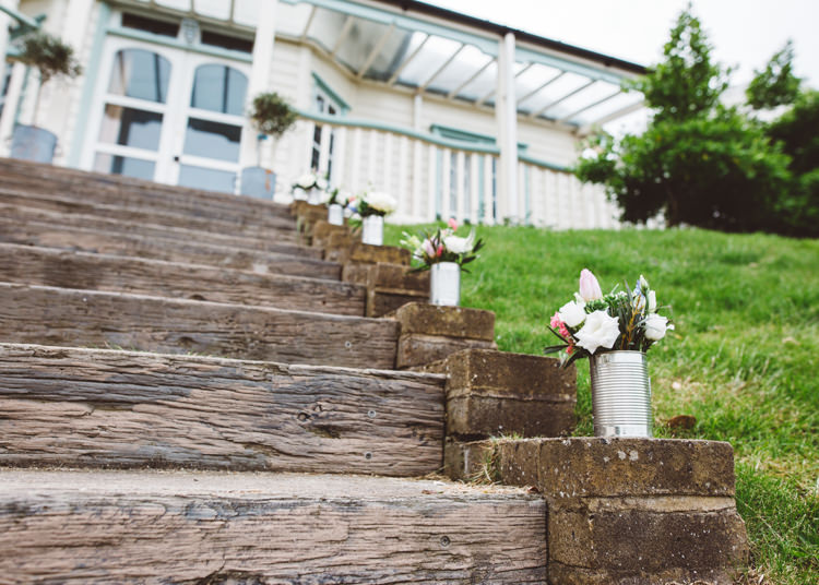 Tin Can Flowers Stairs Steps Low Key Pastel Seaside Wedding http://holliecarlinphotography.com/