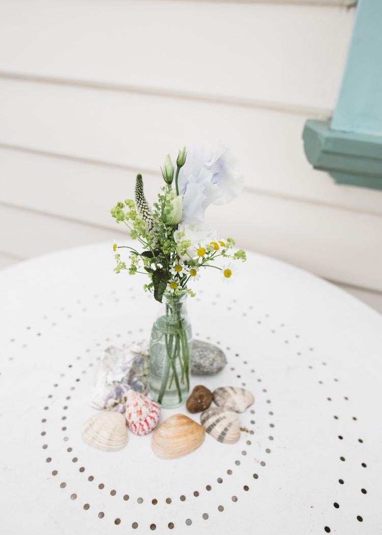 Bottle Flowers Shells Decor Low Key Pastel Seaside Wedding http://holliecarlinphotography.com/