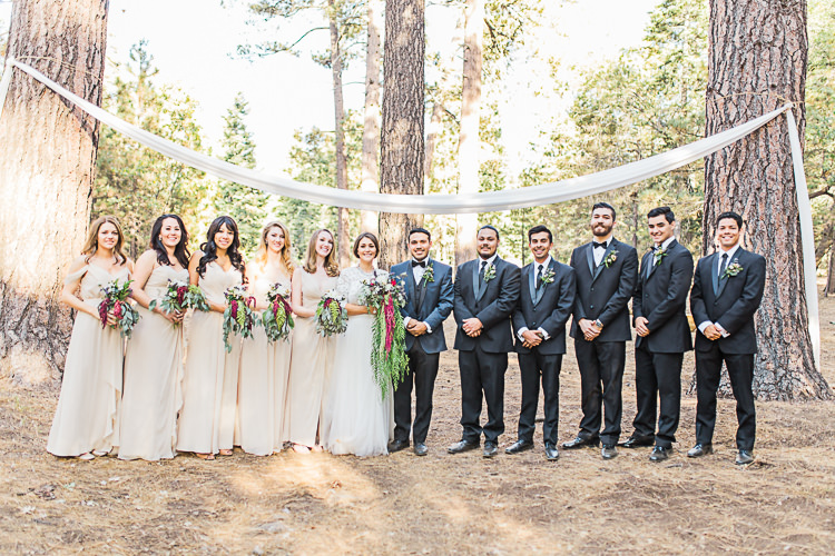 Bridal Party Bride Watters Separates Lace Top Tulle Skirt Cascading Multicoloured Bouquet Bridesmaids Ivory Dresses Groom Dark Blue Jacket Black Satin Lapel Black Pants Black Bowtie Groomsmen Black Suits Black Bowties Ties Ceremony Location Hanging Soft Fabric Trees DIY Whimsical Camp Wedding California http://www.landbphotography.org/