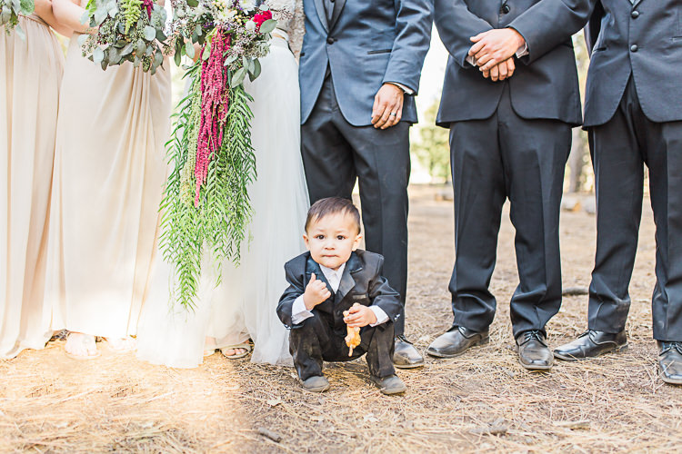 Cute Pageboy Black Suit Bridal Party Bride Cascading Multicoloured Bouquet Groom Dark Blue Jacket Black Pants Bridesmaids Groomsmen DIY Whimsical Camp Wedding California http://www.landbphotography.org/